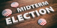 Buttons with the American flag on a table with the words: Midterm Election.